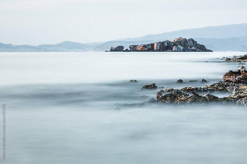 Rocky shoreline by Helen Sotiriadis for Stocksy United
