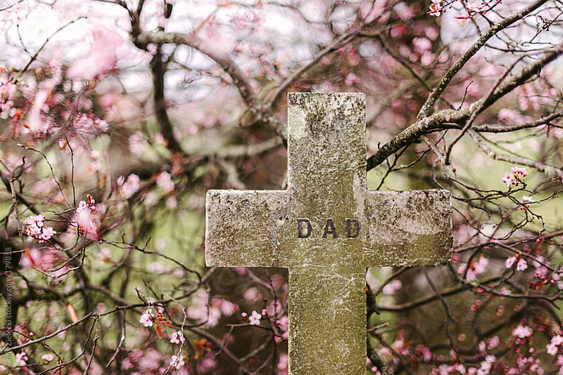 Grave of Dad in spring by Christian Zielecki for Stocksy United