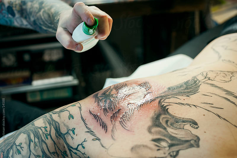 Tattoo Session: Spraying On Antiseptic by Cameron Whitman for Stocksy United