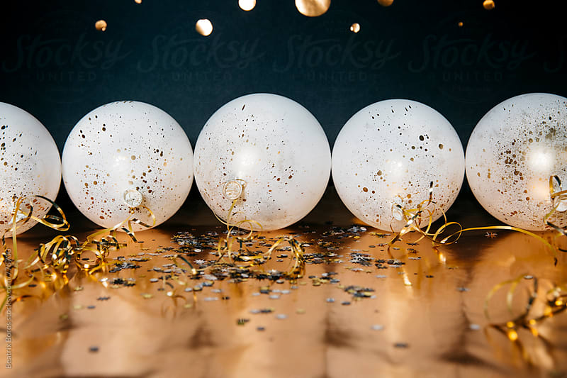 Party balloons with shiny confetti by Beatrix Boros for Stocksy United