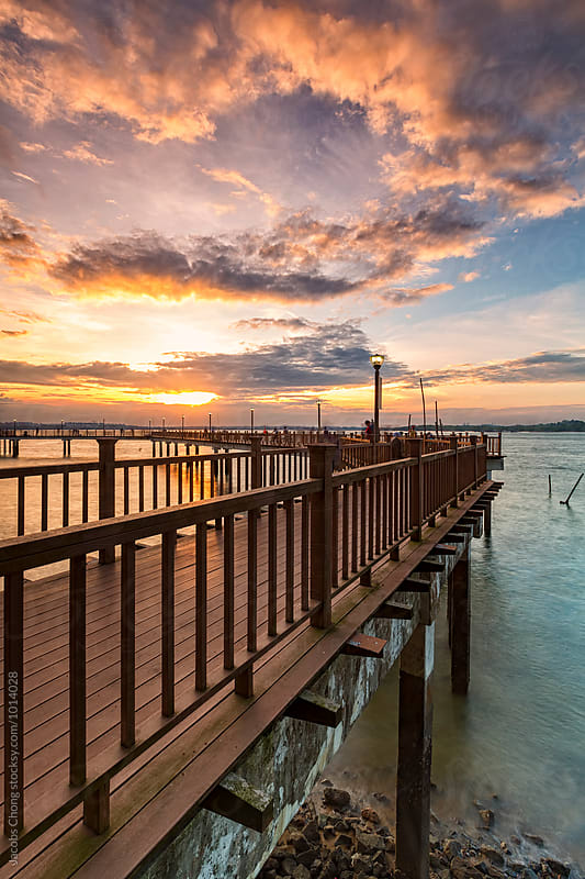 Sunset at Changi board walk by Jacobs Chong for Stocksy United