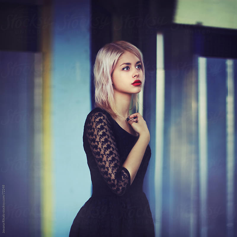 Model posing in urban surroundings. by Jovana Rikalo for Stocksy United