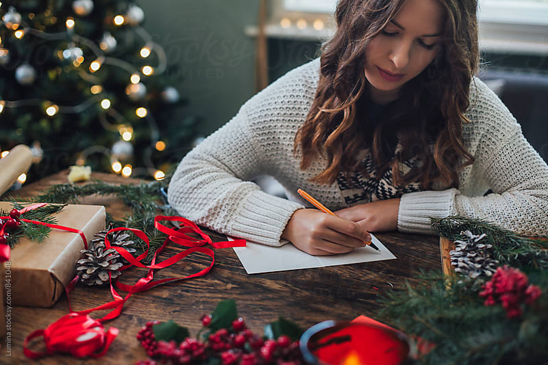 Woman Writing Christmas Cards by Lumina for Stocksy United