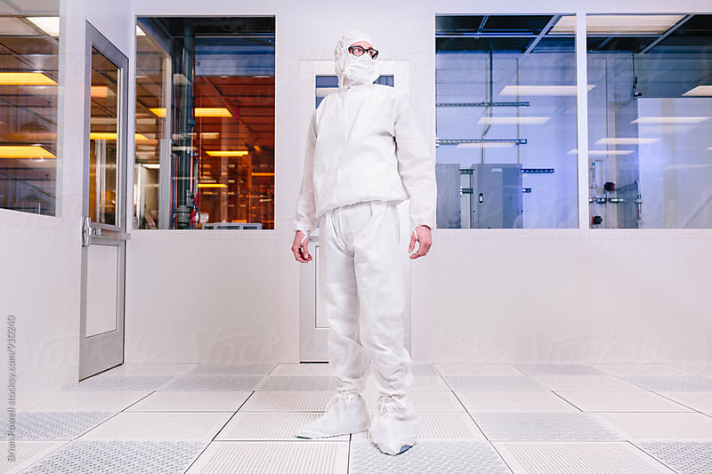 scientist in empty clean room by Brian Powell for Stocksy United