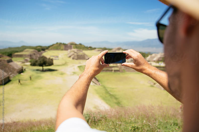Man taking photo of beautiful Mexican landscape by Alejandro Moreno de Carlos for Stocksy United