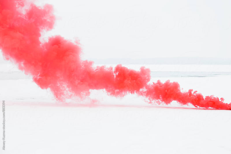 red smoke  by Alexey Kuzma for Stocksy United