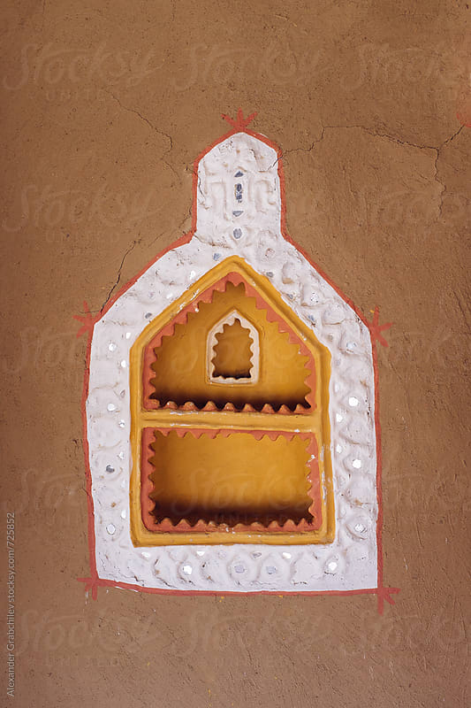 Decorated art mud wall of a traditional hut in India by Alexander Grabchilev for Stocksy United