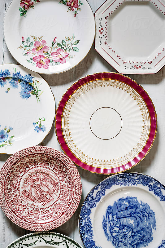 Selection of mismatched vintage plates. by Darren Muir for Stocksy United
