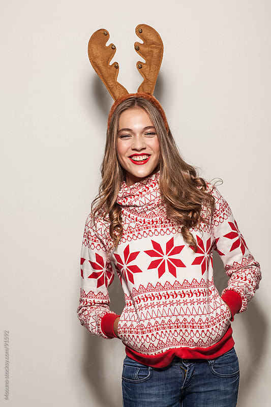 Woman with Reindeer Horns Laughing by Mosuno for Stocksy United