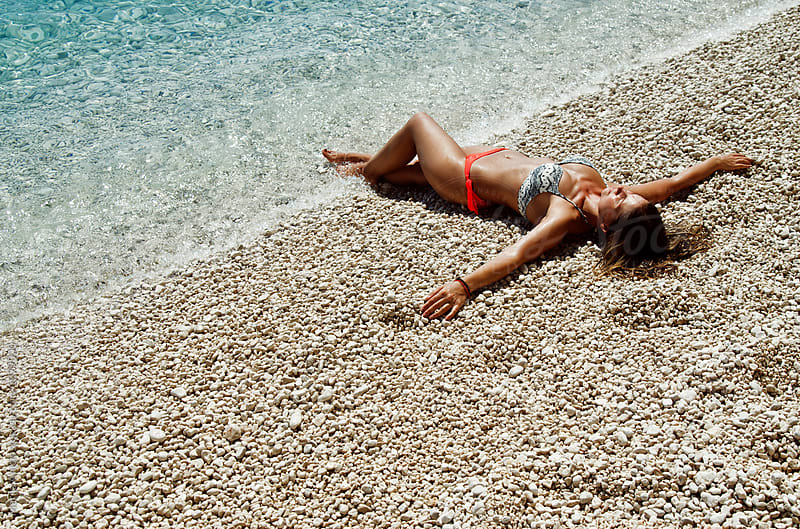 On the beach by Marija Anicic for Stocksy United