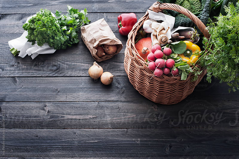 Food: Fresh Vegetables in a Shopping Basket on a Wooden Table by Ina Peters for Stocksy United