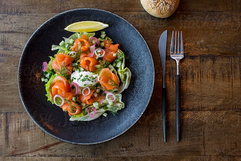 Salmon salad on rustic wood by Todd Beltz for Stocksy United