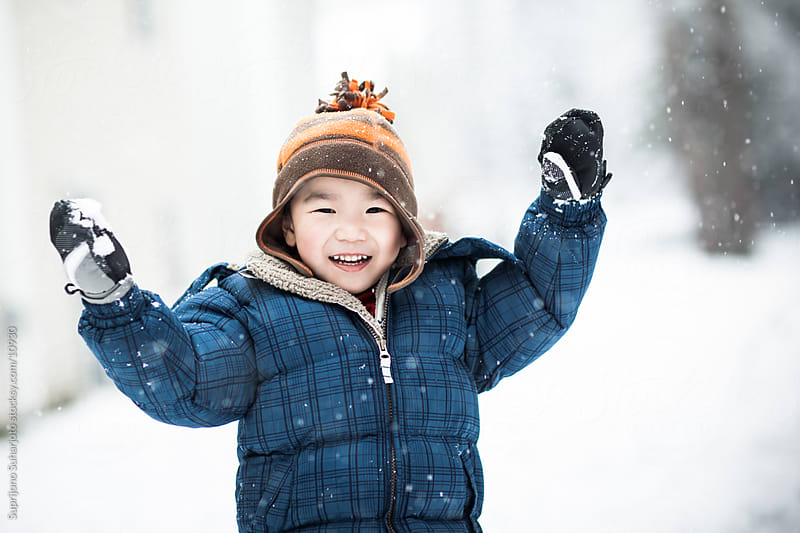 Asian boy playing snow outdoor in winter by Suprijono Suharjoto for Stocksy United