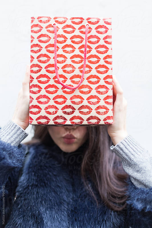 Woman Holding A Shopping Bag with a Kiss Pattern by Mattia Pelizzari for Stocksy United