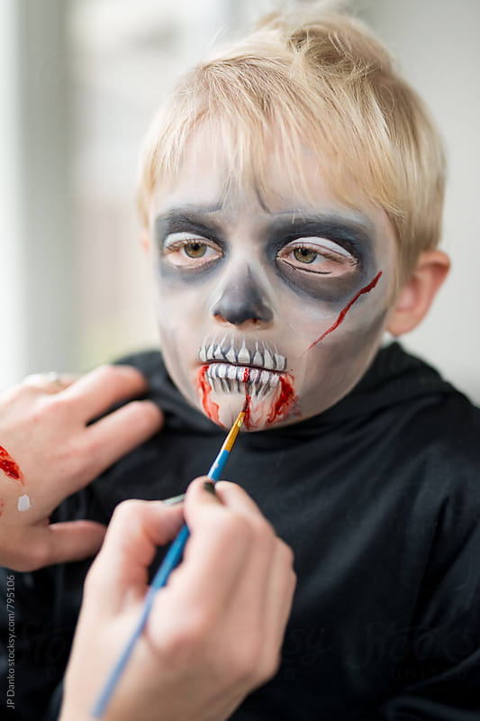Mother Applying Little Boys Gory Halloween Costume Make Up by JP Danko for Stocksy United