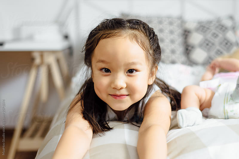 Portrait of adorable girl at home by Maa Hoo for Stocksy United