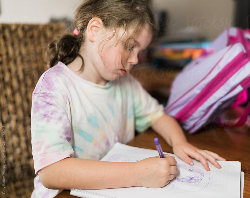 Girl Drawing at a Table by Gary Radler Photography for Stocksy United