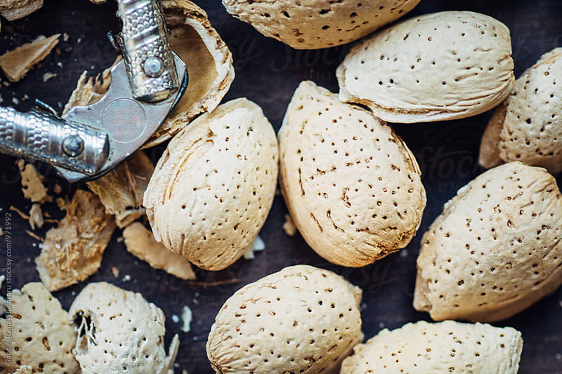 Macro of almonds in their shells by Gabriel (Gabi) Bucataru for Stocksy United