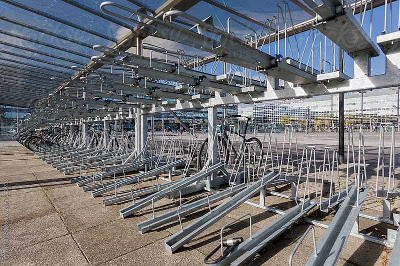 Two-tier secure bicycle parking in a city centre by Paul Phillips for Stocksy United