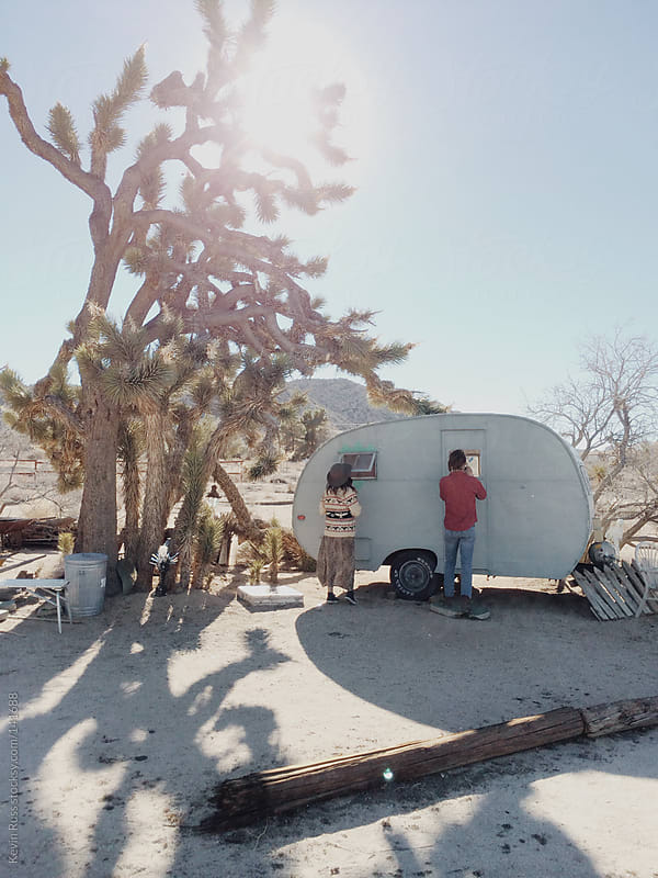 People By Desert Trailer by Kevin Russ for Stocksy United