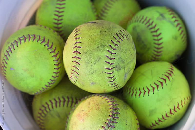 Close up of a full bucket of softballs by Carolyn Lagattuta for Stocksy United