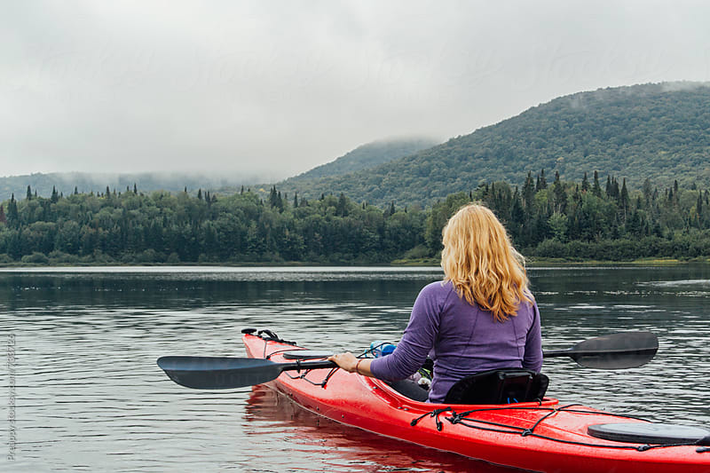 Rear view of woman kayaking by Preappy for Stocksy United