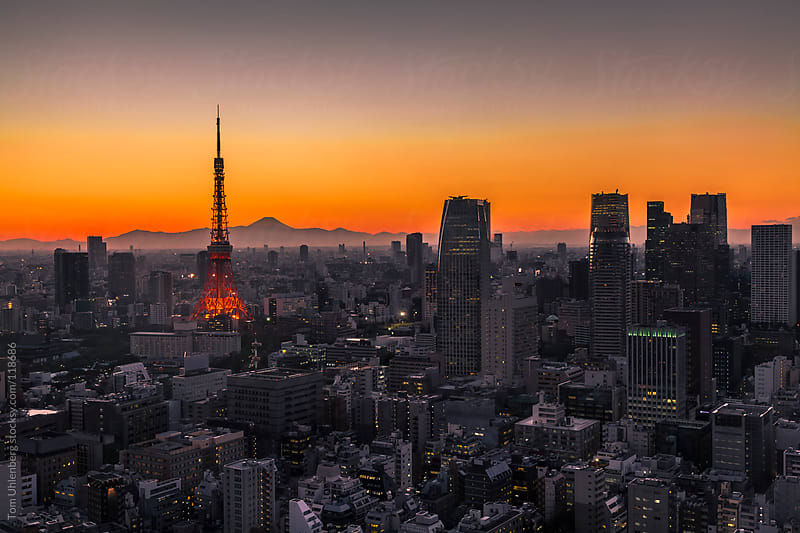 Tokyo Skyline at Sunset with Mt. Fuji in the Background by Tom Uhlenberg for Stocksy United