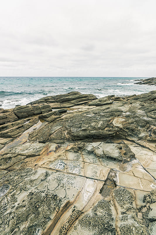 The rocky coastline scarred by erosion in Southern Australia by suzanne clements for Stocksy United