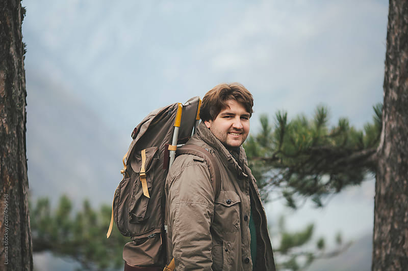 Smiling Hiker With a Backpack by Lumina for Stocksy United