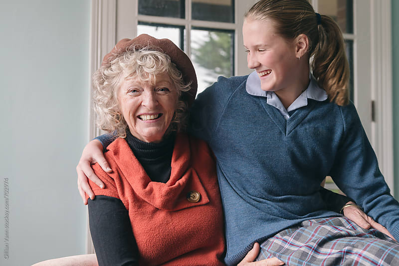 grandmother with granddaughter, sharing a laugh by Gillian Vann for Stocksy United