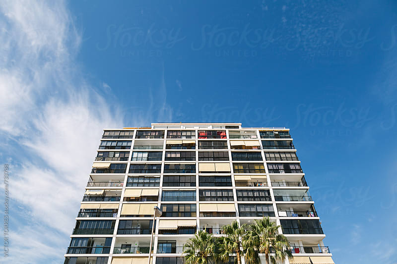 Big Apartments Building Against a Radiant Blue Sky by VICTOR TORRES for Stocksy United