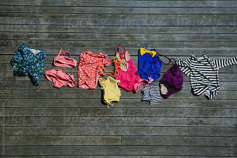 kids' swimsuits dry in the summer sun by Rebecca Zeller for Stocksy United