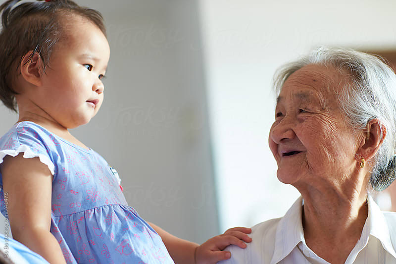 senior asian woman with her great grandmother by Bo Bo for Stocksy United