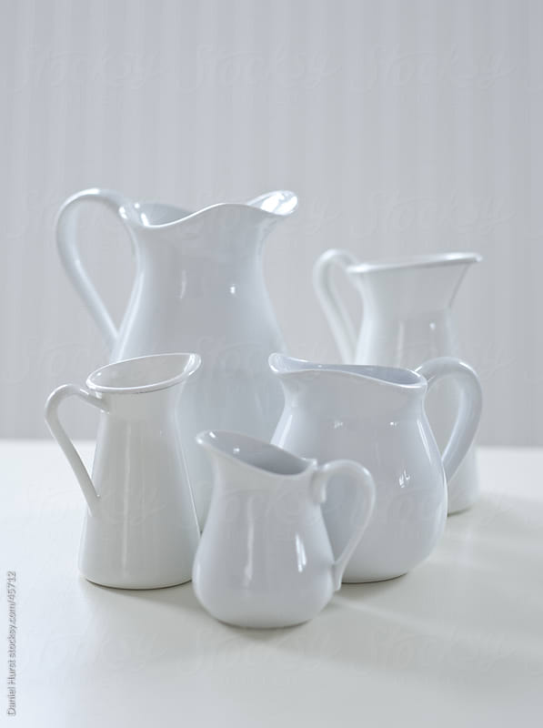 Assortment of white pitchers by Daniel Hurst for Stocksy United