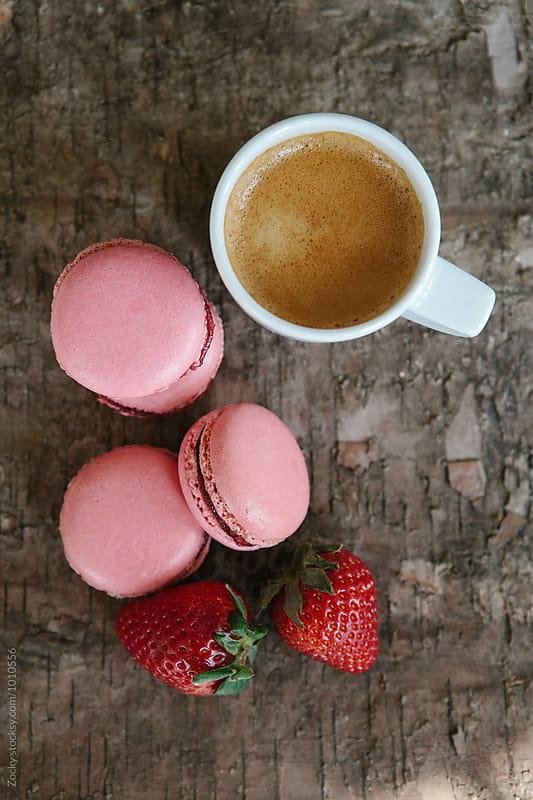 Strawberry macarons with coffee by Zocky for Stocksy United