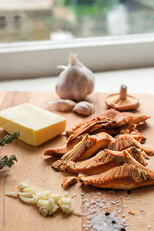 breakfast ingredients, pine mushrooms with butter and garlic by Gillian Vann for Stocksy United