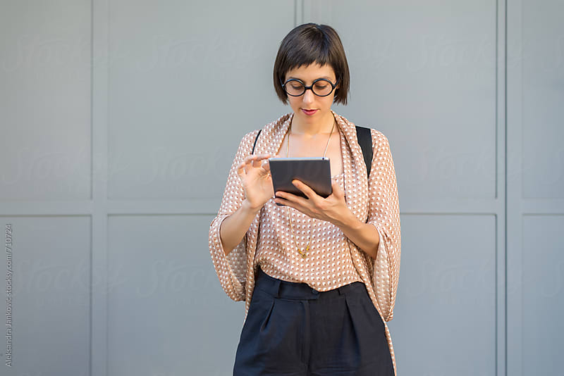 Stylish Businesswoman Using Tablet Computer by Aleksandra Jankovic for Stocksy United