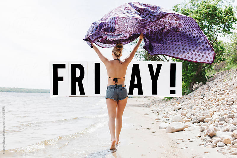 Friyay block letters over image of girl on beach by Carey Shaw for Stocksy United