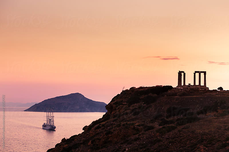 Ancient Greek Temple Next to the Sea with Boat by Helen Sotiriadis for Stocksy United
