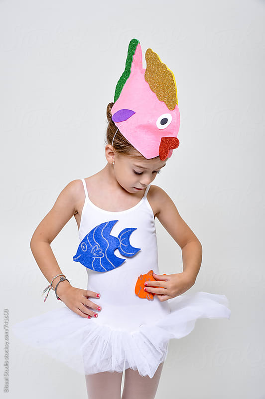Little ballerina wearing a fish hat before a rehearsal by Bisual Studio for Stocksy United