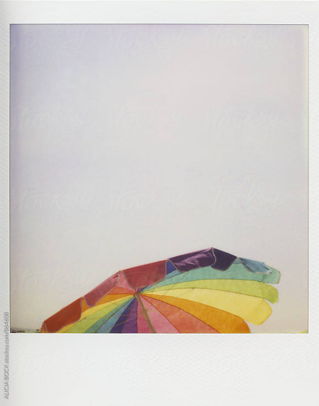 Polaroid Photograph Of A Multi-Colored Beach Umbrella by ALICIA BOCK for Stocksy United