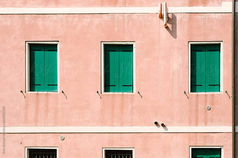 Green shutters by Sam Burton for Stocksy United
