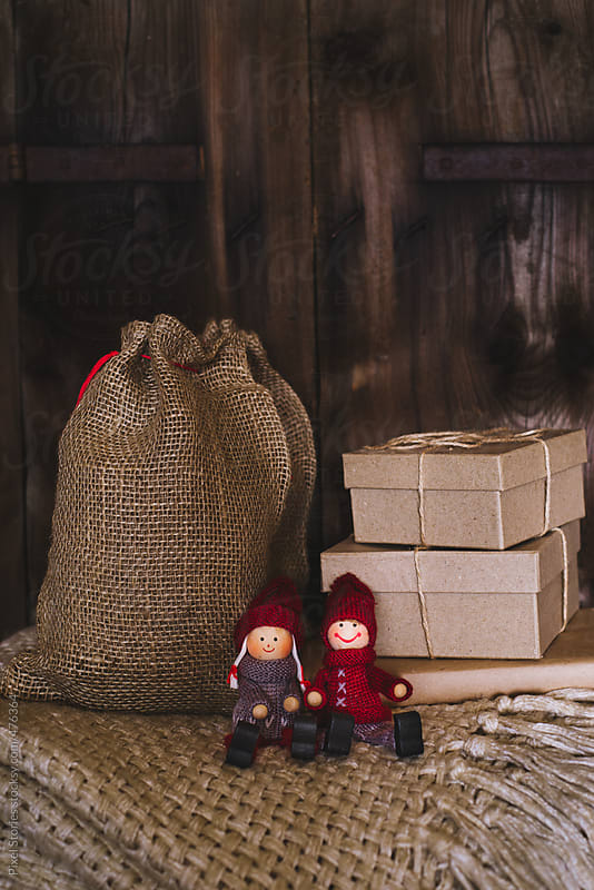 Two wooden figurines against Christmasy setting by Pixel Stories for Stocksy United