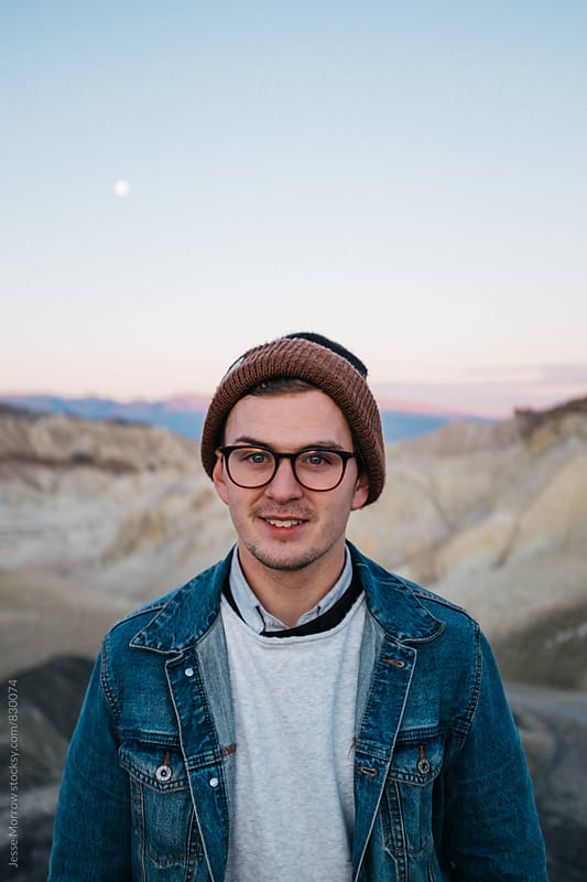 portrait of young male at sunrise in national park landscape by Jesse Morrow for Stocksy United