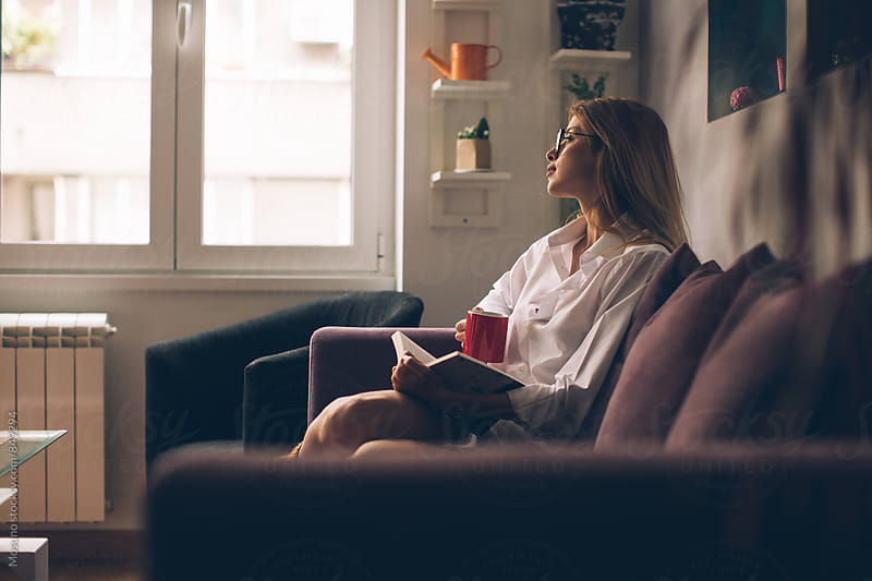 Young Woman Relaxing at Home by Mosuno for Stocksy United