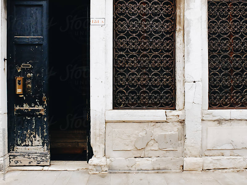 An old door in a venetian street by Anna Malgina for Stocksy United