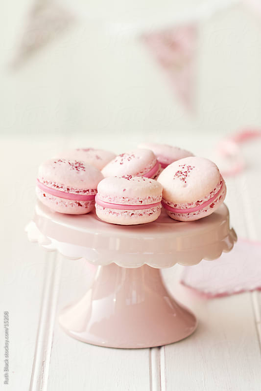 Strawberry macarons on a cakestand by Ruth Black for Stocksy United