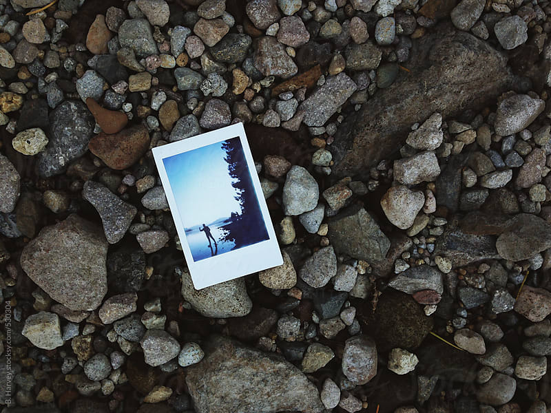 Poloroid Picture Sitting on a Pebbled Beach by B. Harvey for Stocksy United