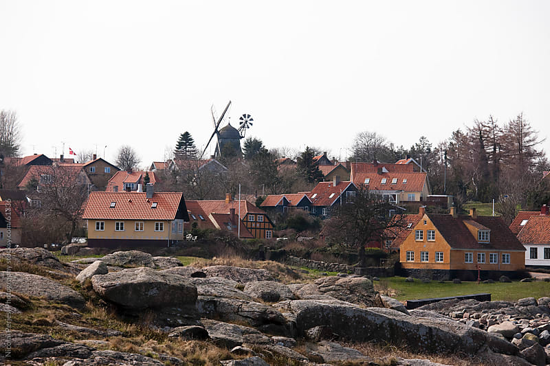 Village with windmill. by Nicolai Perjesi Photography for Stocksy United