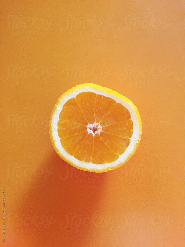 Orange on a table by Jovana Rikalo for Stocksy United